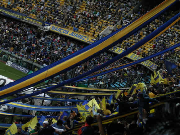 A crowd at a La Boca game in La Bombanera Stadium. See a First Division Soccer Game live while in Buenos Aires with Wander Argentina