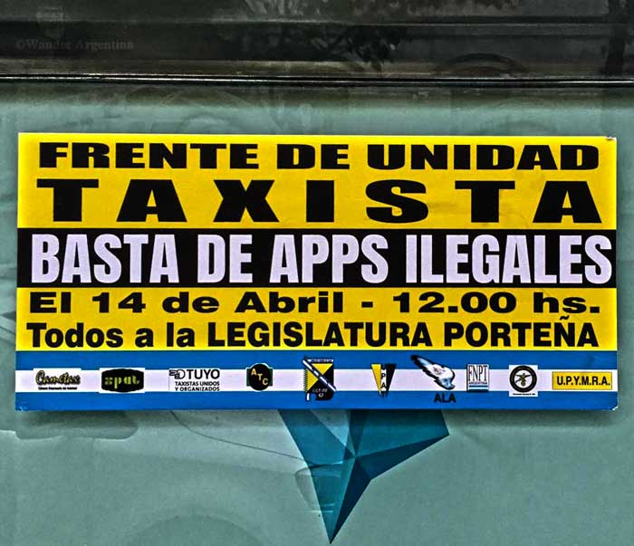 A sign advertising a protest among taxi drivers against UBER in Buenos Aires