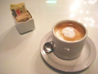 A cup of cafe con leche or coffee and milk as served in a cafe in Buenos Aires, Argentina