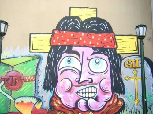 A mural of folk saint, Gauchito Gil, in Buenos Aires.