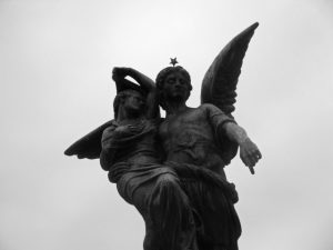 A tomb of two angels holding each other in Recoleta cemetery