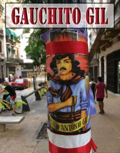 A flyer of Gauchito Gil on a telephone pole in Buenos Aires