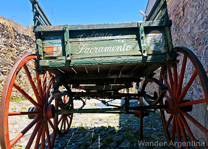 An old cart with the words 'Colonia del Sacramento' painted on it in the historic district of Colonia del Sacramento, Uruguay