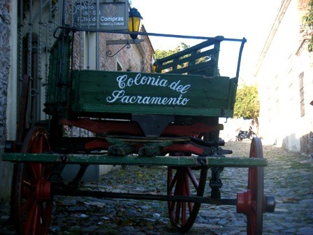 A an old style car tthat says Colonia del Sacramento in the historic district of Colonia del Sacramento, Uruguay.