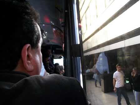 Man looks out the window on Buenos Aires bus 17