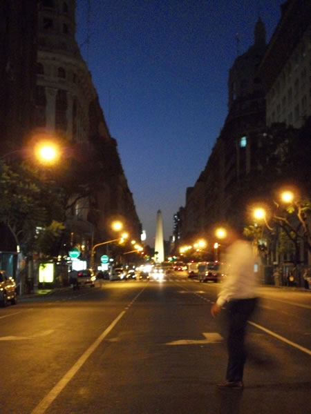 A picture of Buenos Aires' obeslisk at night as seen from Avenida Rividavia