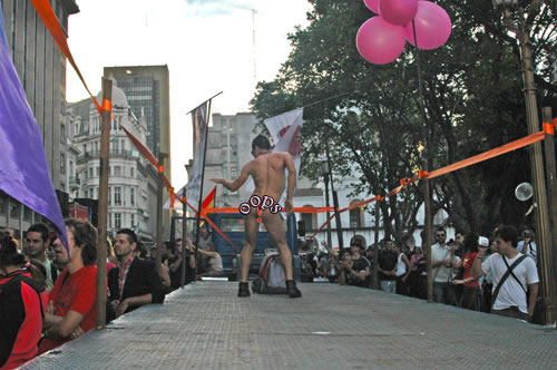 A man dances naked on a float before the Buenos Aires Gay Pride March