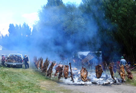 A massive 'asado criollo,' or country-style barbecue, being smoked outdoors in Patagonia