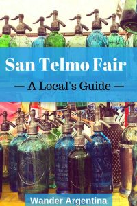 A picture of glass water soda water bottles with the words 'San Telmo Street Fair'