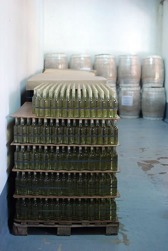 Stacks of old wine bottle in a winery in Cafayate, Salta, Argentina