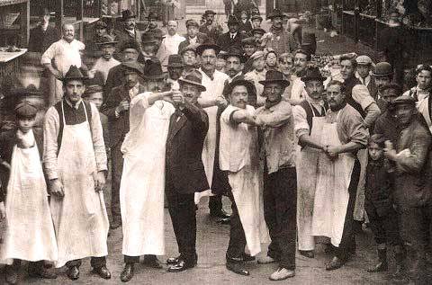 Men dance tango together in the early 20th Century in Buenos Aires