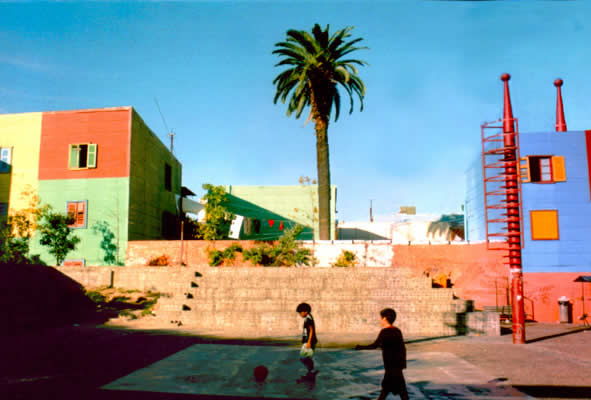 Kids play in the central soccer court in the La Boca neighborhood of Buenos Aires