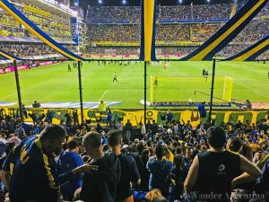 Football fans watch the game in the club member section at La Boca Jrs. Bombonera stadium in the La Boca neighborhood of Buenos Aires