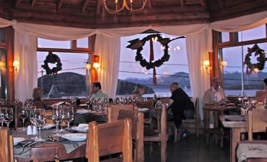 The dining room of El Patacon restaurant in Bariloche, featuring an amazing view of Lake Nahual Huapi