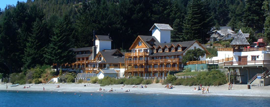 An outside view of Hosteria del Lago in Bariloche from Lake Nahuel Huapi