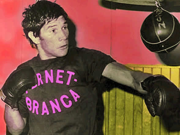 Carlos Monzon training with a punching bag