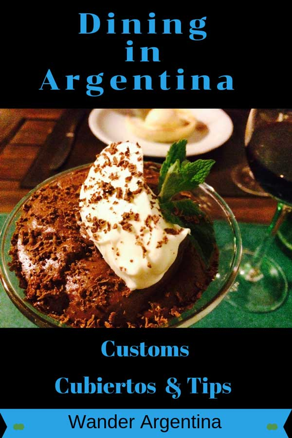 A picture of tiramisu on a dining table with a glass of wine. With the word 'Dining in Argentina: Customs, Cubiertos and Tips'