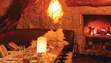 The cozy interior of La Cueva Restaurant in Bariloche, Argentina