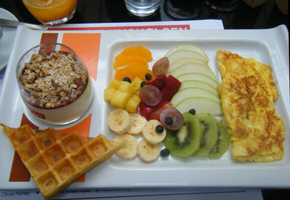 A plate with granola, waffles and fruit from Olsen cafe in Buenos Aires