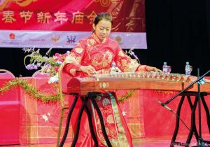 A woman gives a musical performance onstage at Buenos Aires Chinese New Year Celebration
