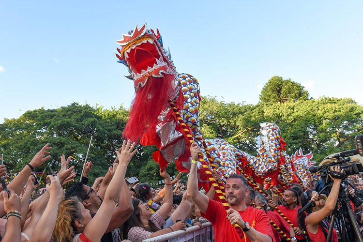 Performers doing the dragon dance during Chinese New Year Celebrations in Chinatown, Buenos Aires, Argentina