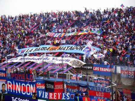 A colorful crowd at an Argentine soccer game