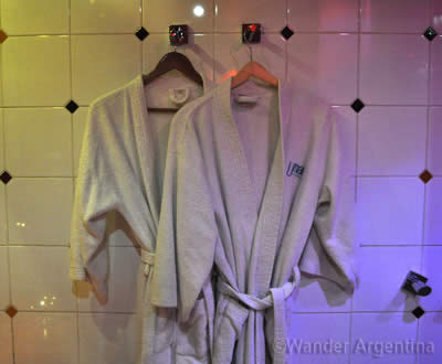 Complimentary robes hang in a Buenos Aires Telo