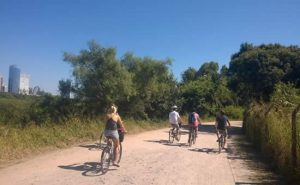 Visitors to Buenos Aires riding bikes in the Ecological Reserve of Buenos Aires. Book a bike tour on Wander Argentina