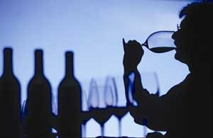 A silhouette of a man tasting wine at a Buenos Aires Wine Cellar