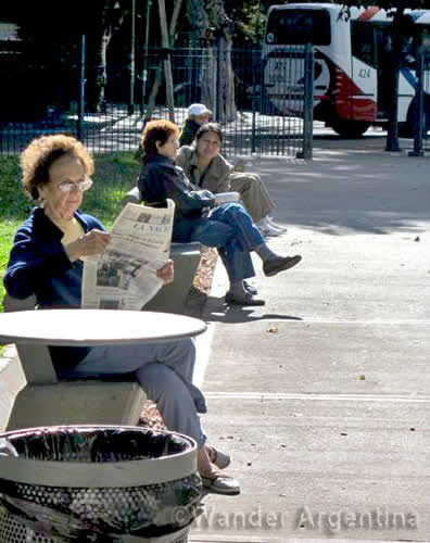 Women sitting on benches in Plaza Almagro