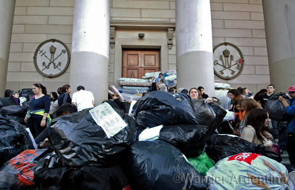 Community members in Buenos Aires sort through donations for flood victims