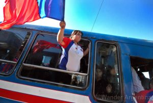 Football fan hangs out of a bus in the Mantanza in the Buenos Aires province