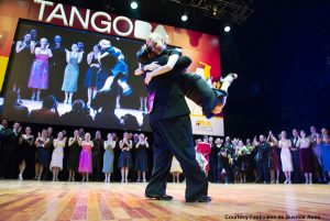 TangoBA winners embrace on stage, celebrating their win