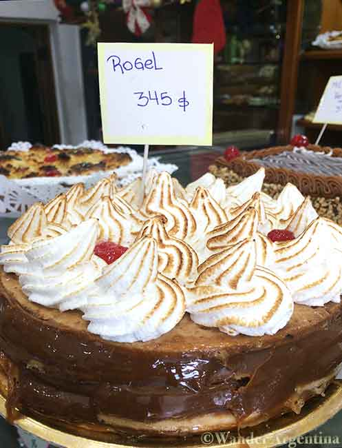 A picture of a 'torta rogel' or Rogel cake, also known as Torta de mil Hojas. A popular layer cake in South America that is topped with Italian merengue
