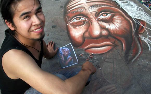 An artist does a chalk drawing on Florida Street in Buenos Aires