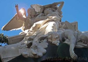A sculptured tomb showing three angels in Recoleta cemetery in Buenos Aires