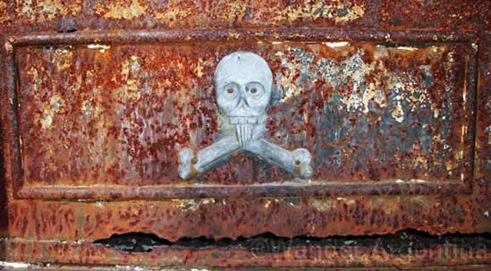 A skull on a rusted tomb door in Recoleta cemetery