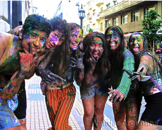 Argentine teens covered in paint celebrate school letting out for summer