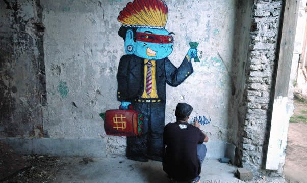Street art of greedy indigenous businessman by street artist, Cranio