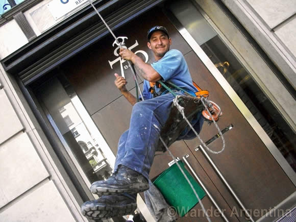 A high-rise window washer in Buenos Aires gives the thumbs up