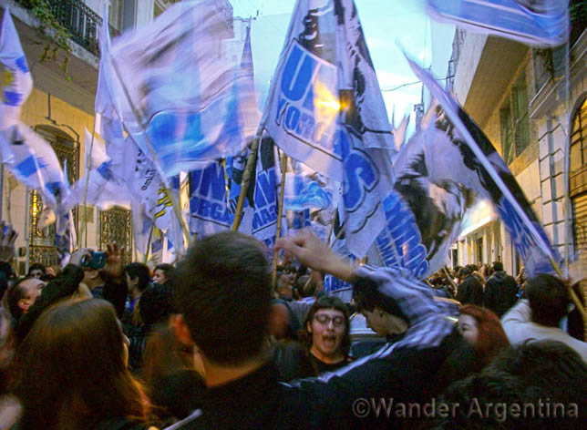 Campora members celebrate on the streets of Buenos Aires on October 25, 2015, on the first round of elections