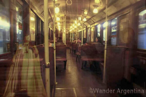 An antique wagon of Buenos Aires Line A of the subway with apparitions