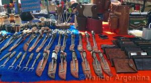 A display of cutlery and leather goods