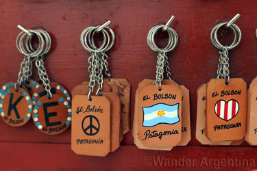 Souvenirs in El Bolson . A display of keychains that say 'El Bolson'.
