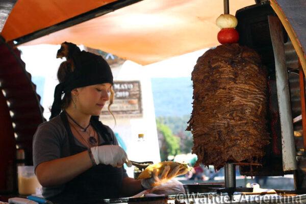 A woman prepares Shawarma in El Bolson, Argentina
