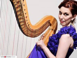 American musician, Sarah Stern with her harp