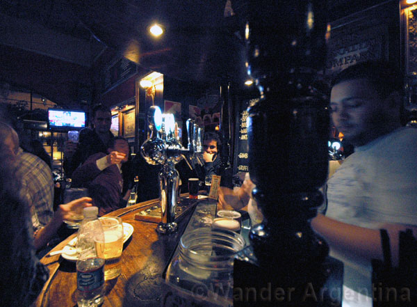 A picture of the bartender and patrons at GIbraltar pub in San Telmo Buenos Aires.
