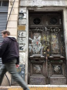 The old wooden door at the former home of Sumo singer Luca Proden in Monserrat, Buenos Aires