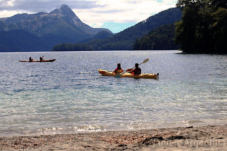People in kayaks enjoy Nahuel Huapi Lake in Patagonia, Argentina