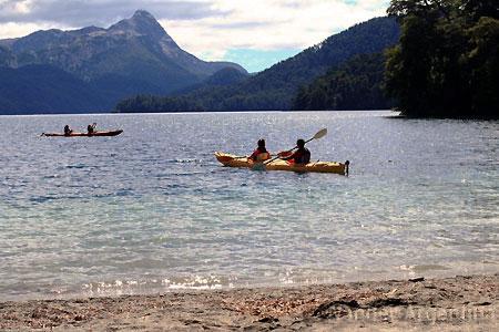 People in kayaks enjoy Nahuel Huapi Lake in Patagonia, Argentina